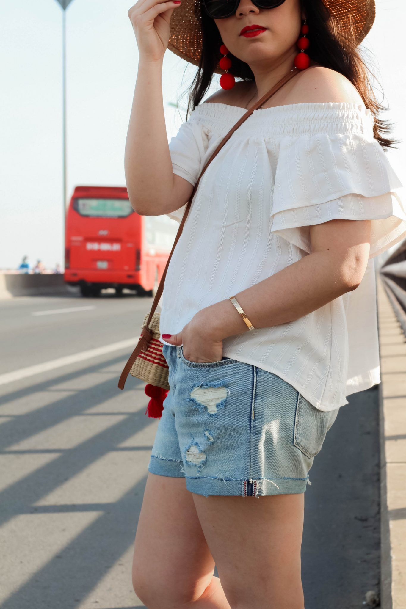 The Classic Quintessential Summer Look on the Cần Thơ Bridge by popular New York fashion and travel blogger Live Laugh Linda