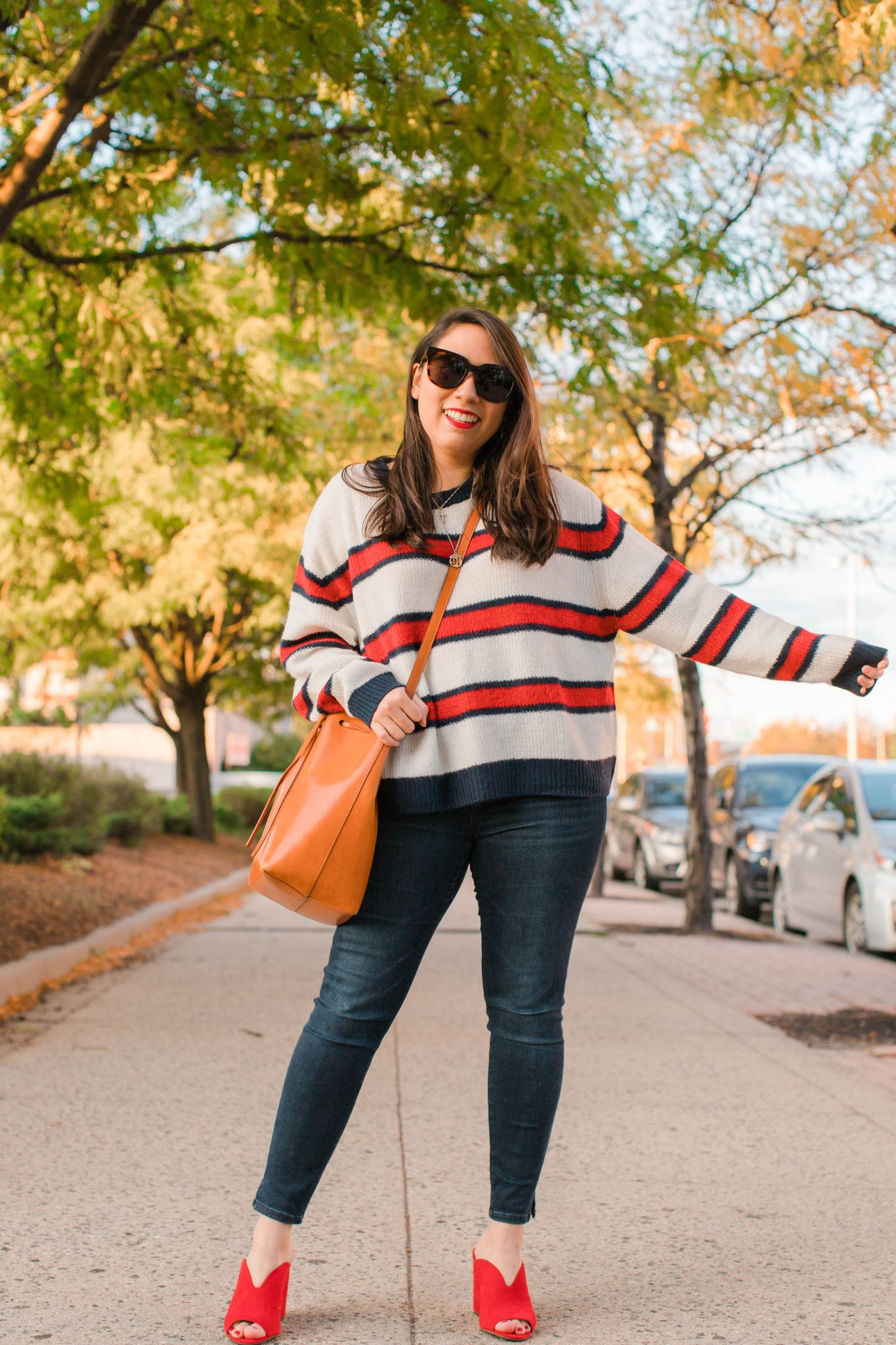 Living With Social Anxiety featured by top US lifestyle blog Live Laugh Linda; Image of woman wearing H&M sweater, Abercrombie & Fitch denim, BP shoes. Mansur Gavriel bag, Alex & Ani necklace and Gentle Monster sunnies