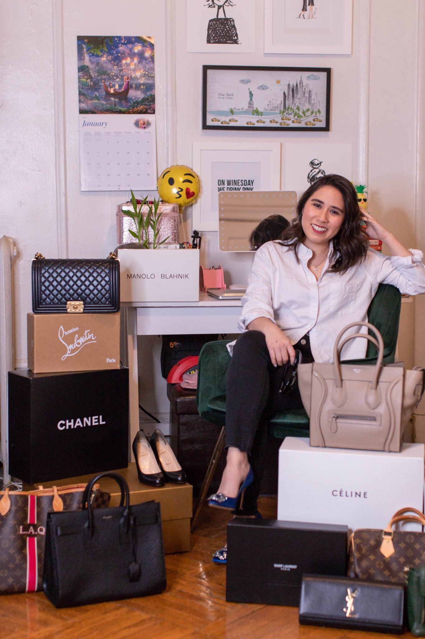 Luxury Accessories featured by US fashion blogger Live Laugh Linda; Image of woman sitting in living room with purses.