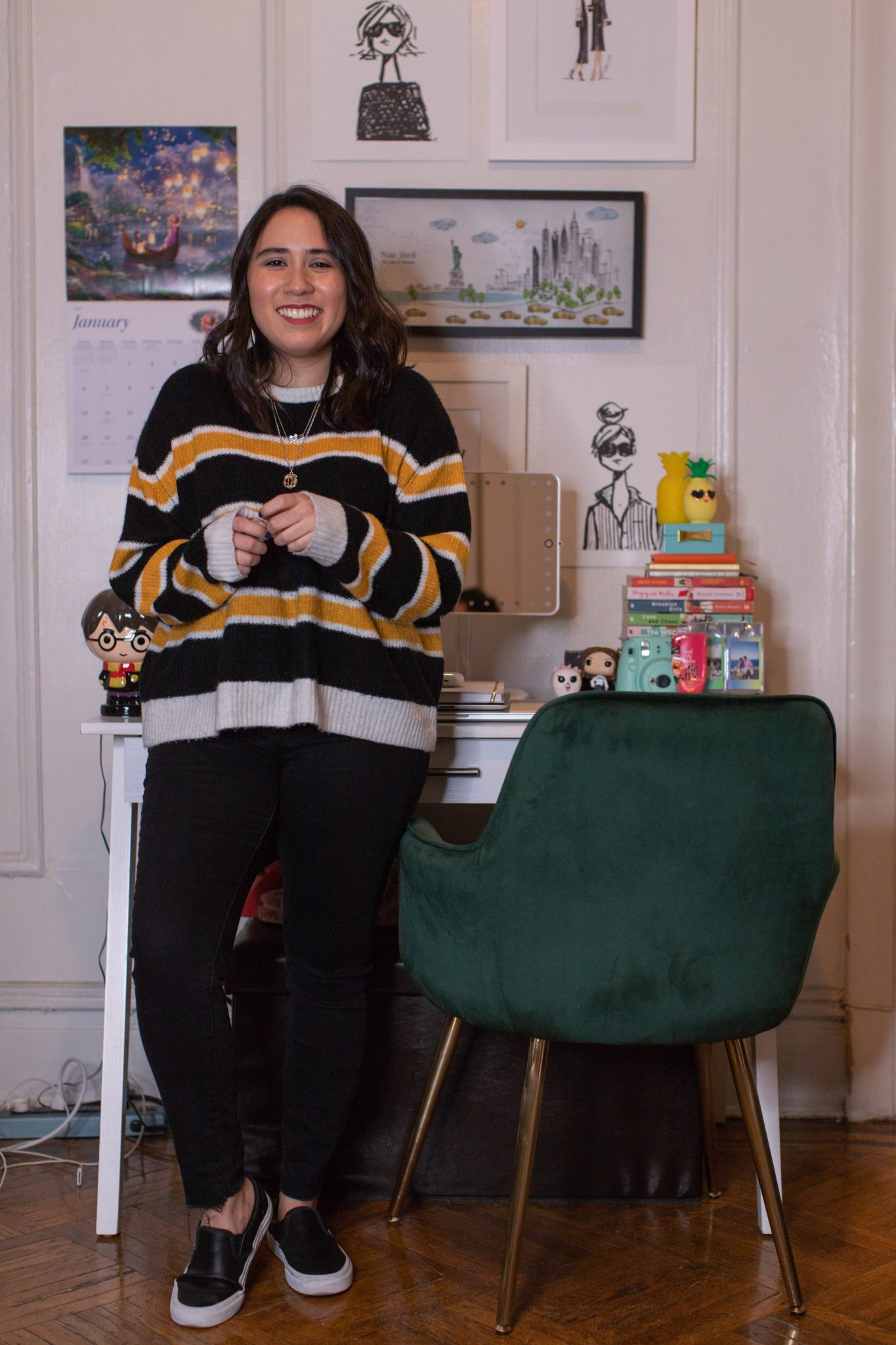 Winter Work Wardrobe featured by top US fashion blogger Live Laugh Linda; Image of woman wearing H&M sweater, Levi super skinny ankle jeans, QVC Mickey necklace, Alex and Ani Harry Potter necklace and Vans classic black sneakers.