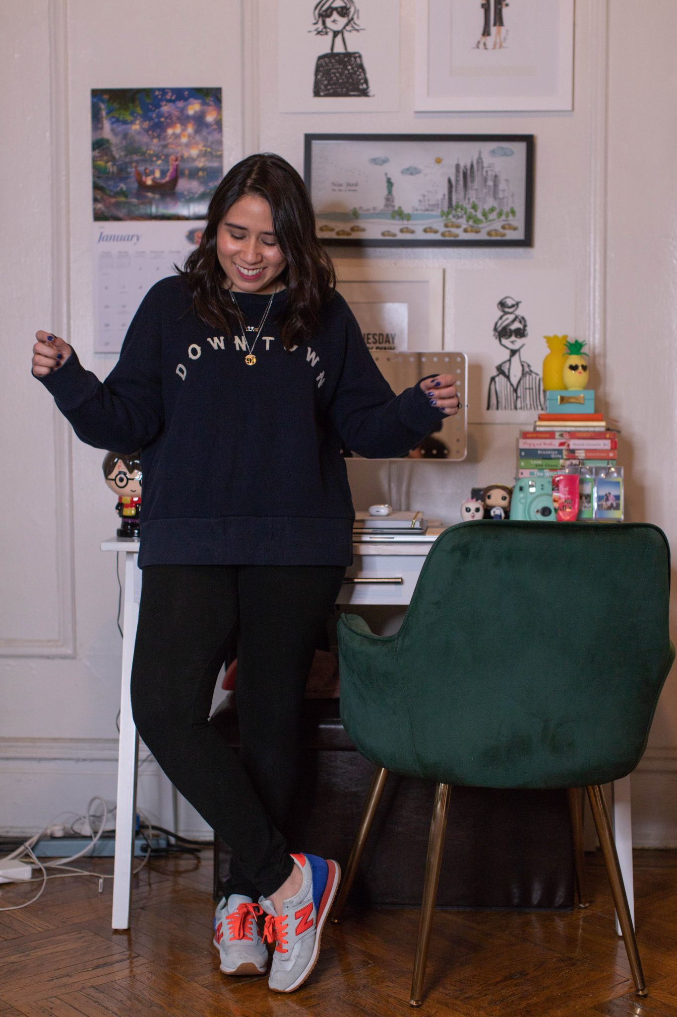 Winter Work Wardrobe featured by top US fashion blogger Live Laugh Linda; Image of woman wearing Madewell sweater, Victoria Sport anytime leggings, QVC Mickey necklace, Alex and Ani Harry Potter necklace and J.Crew sneakers.