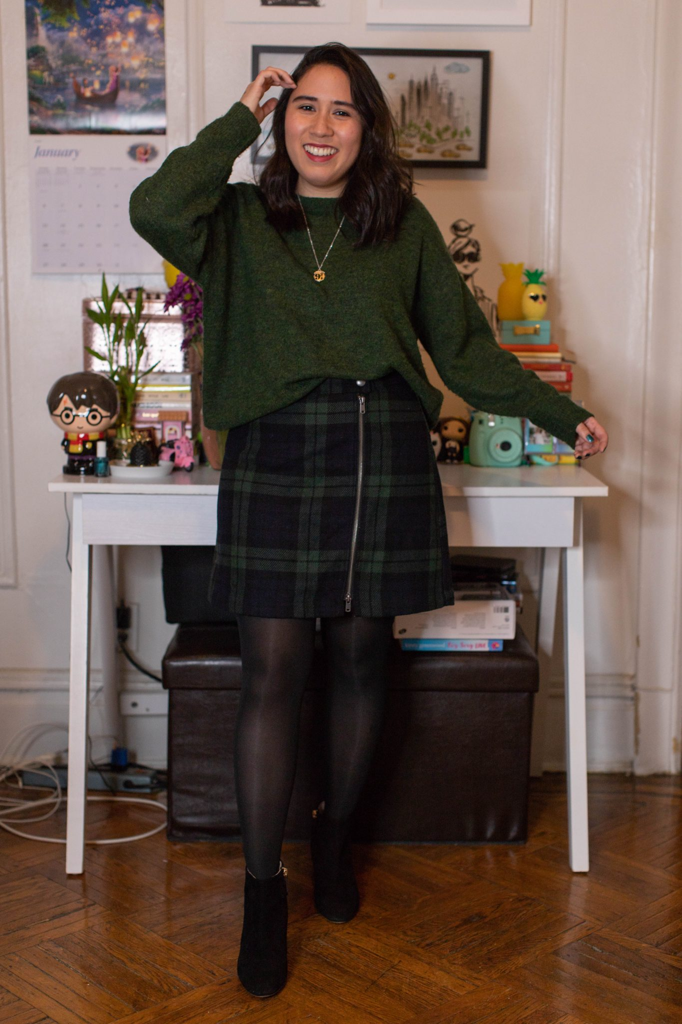 Winter Work Outfits featured by top US fashion blogger, Live Laugh Linda; Image of woman wearing H&M sweater, Abercrombie & Fitch min skirt, Steve Madden bootie and Alex and Ani Harry Potter necklace