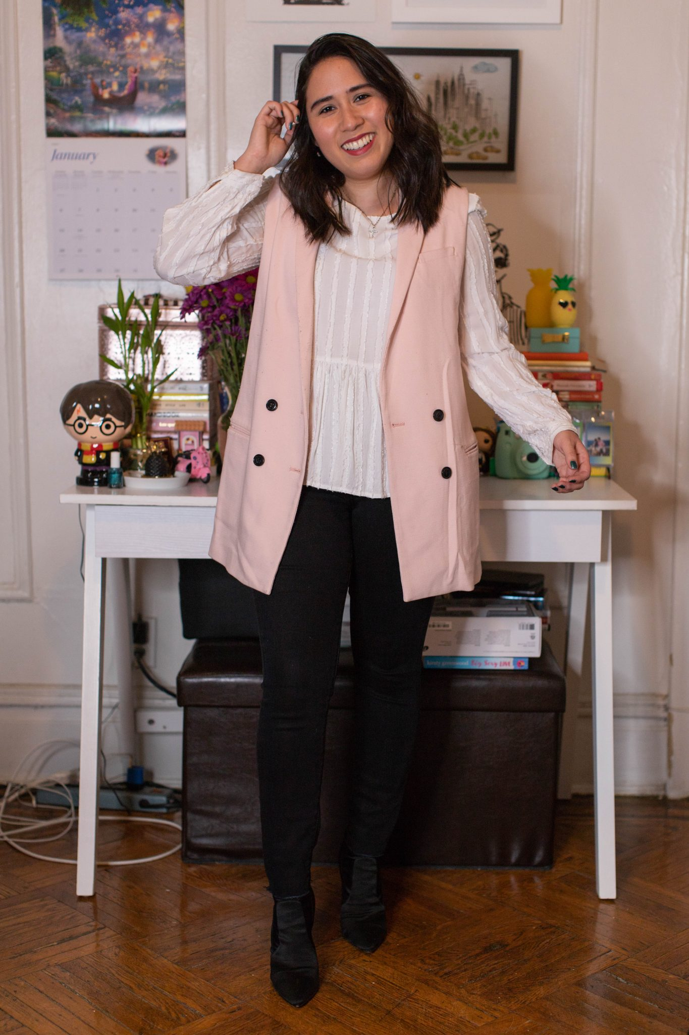 Winter Work Outfits featured by top US fashion blogger, Live Laugh Linda; Image of woman wearing ASOS vest, Loft peplum blouse, Levi's skinny jeans and Steve Madden booties