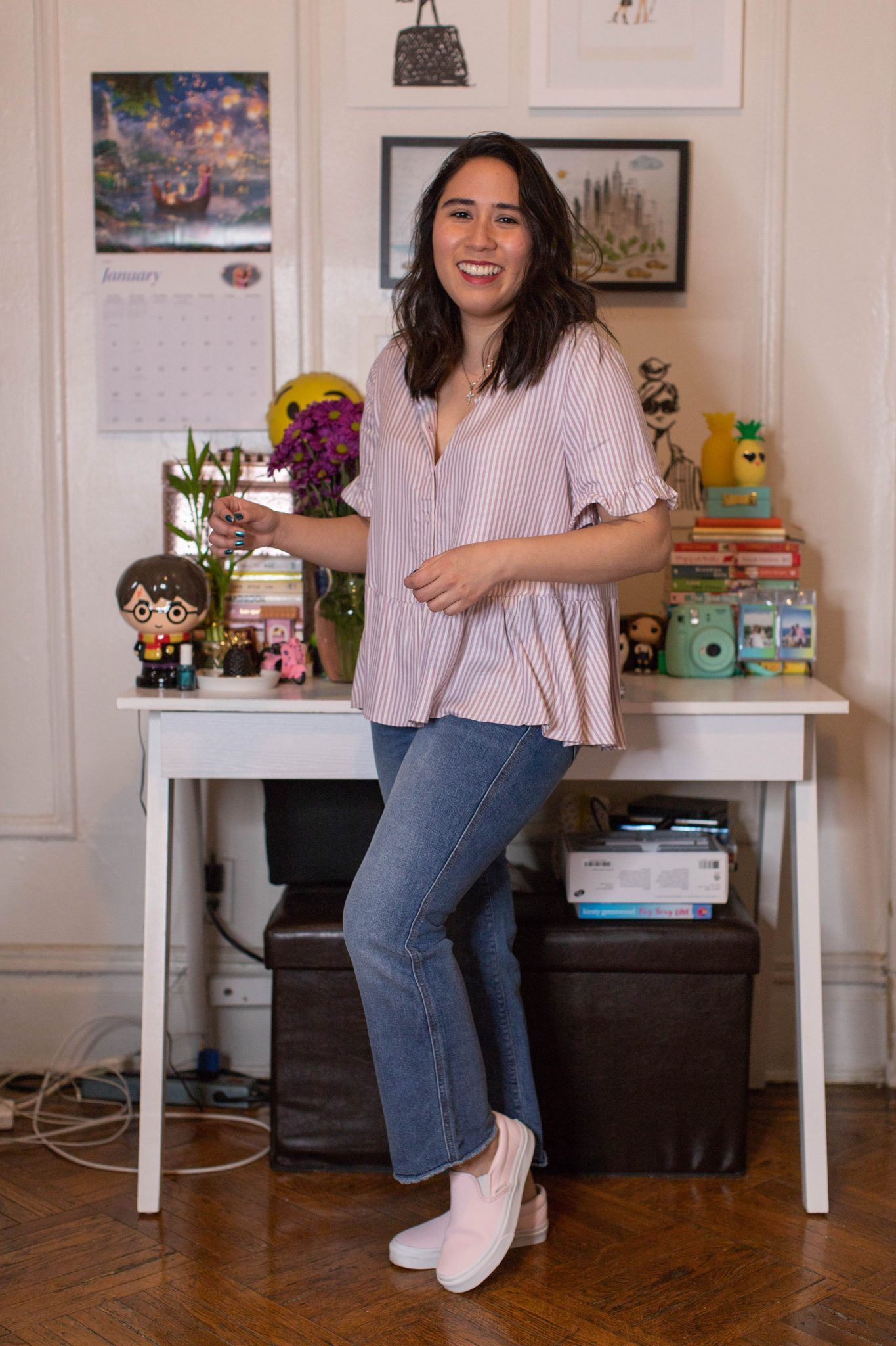 Winter Work Outfits featured by top US fashion blogger, Live Laugh Linda; Image of woman wearing Madewell ruffle top, Loft jeans and Vans sneakers