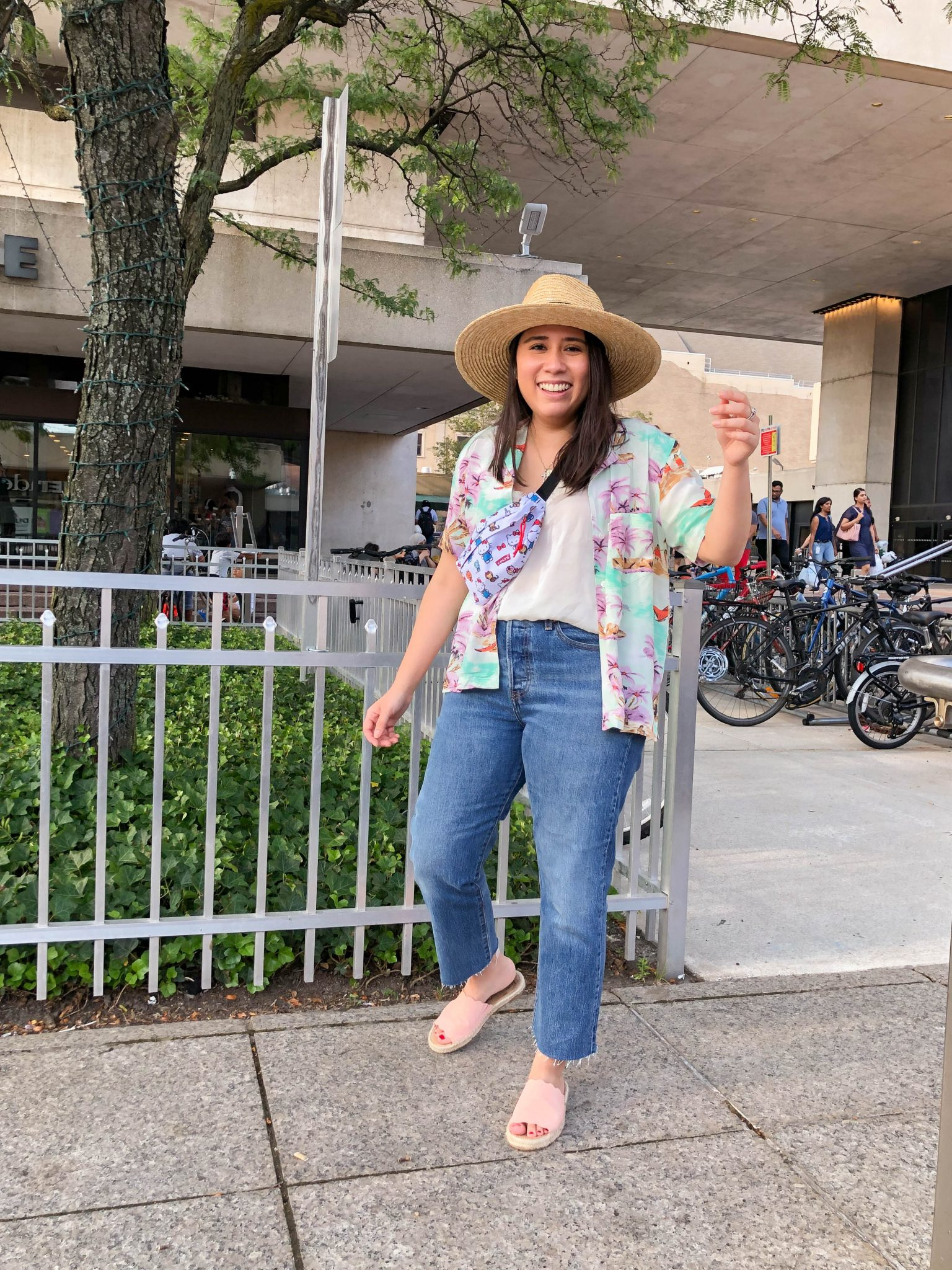 Week In Review :: A Friday Favorites Weekly Roundup by popular New York life and style blog, Live Laugh Linda: image of a woman standing outside wearing a straw hat, tropical print button up, and Levi's Wedgie Fit Straight Women's Jeans.