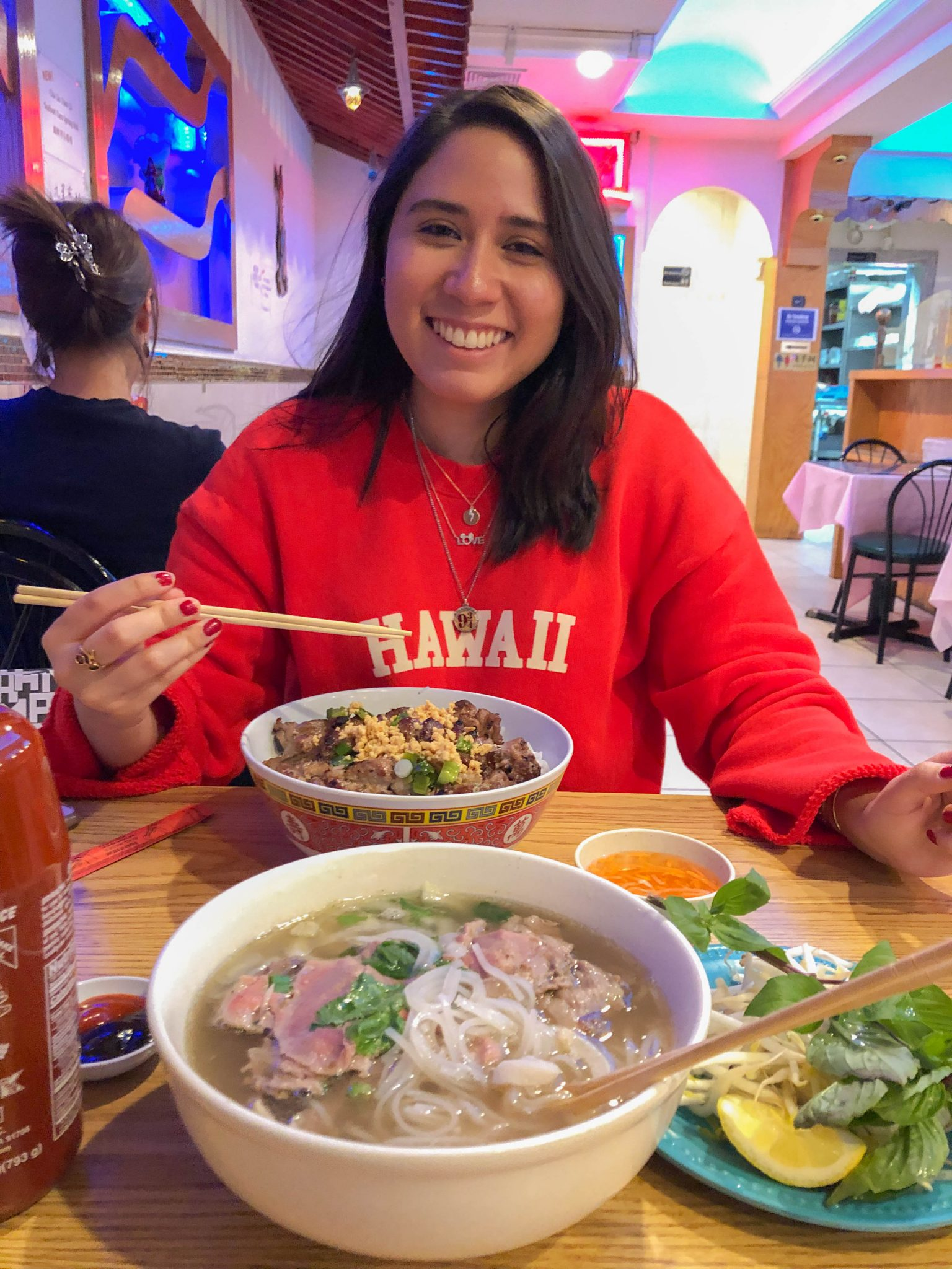 Friday Favorites :: Vietnamese Vacation 2020 by popular New York City lifestyle blog, Live Laugh Linda: image of a woman eating Vietnamese food.