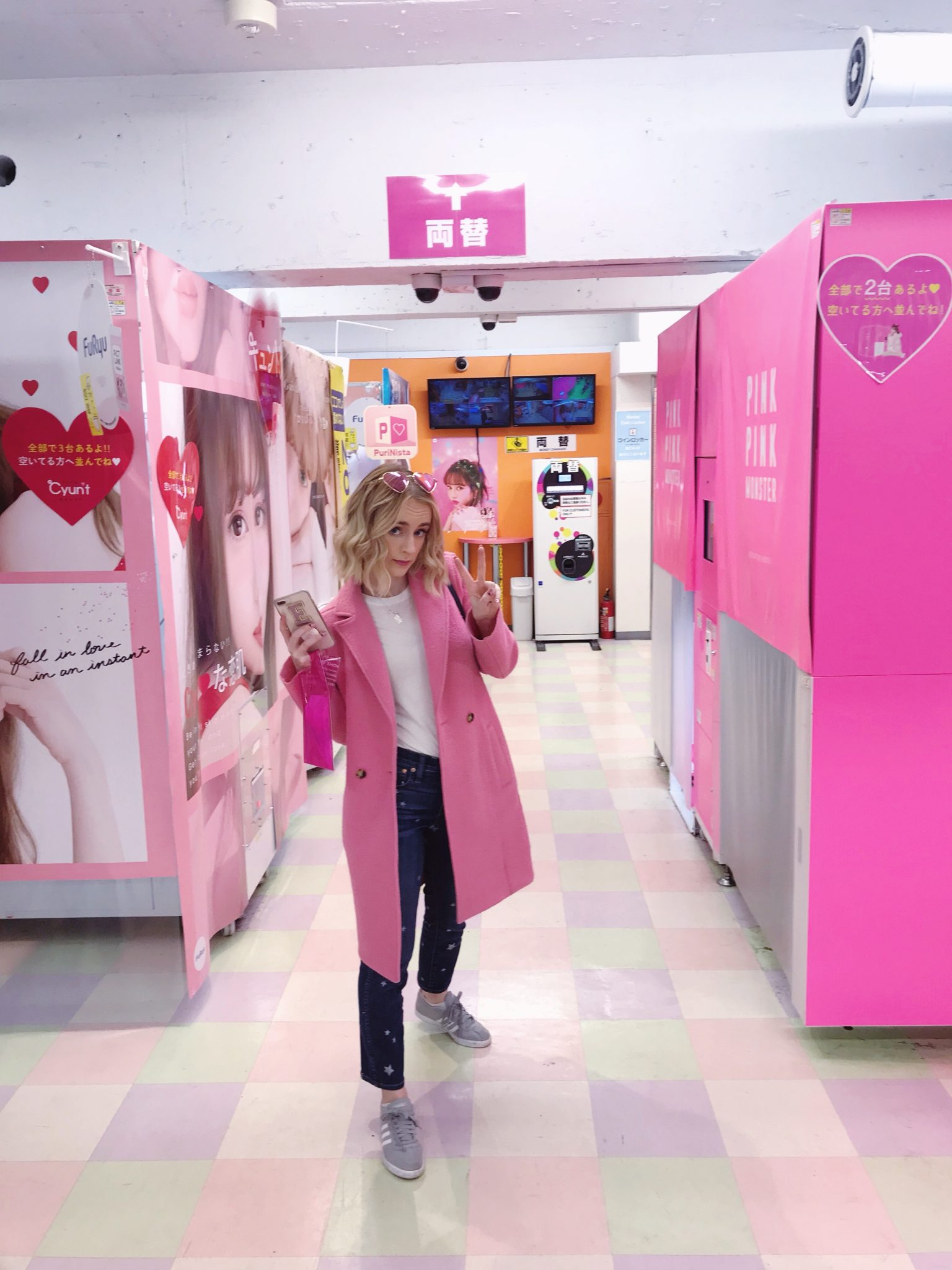 Friends In New York City :: Meet Emma - Associate Publicist by popular New York lifestyle blog, Live Laugh Linda: image of a woman standing by some pink vending machines.