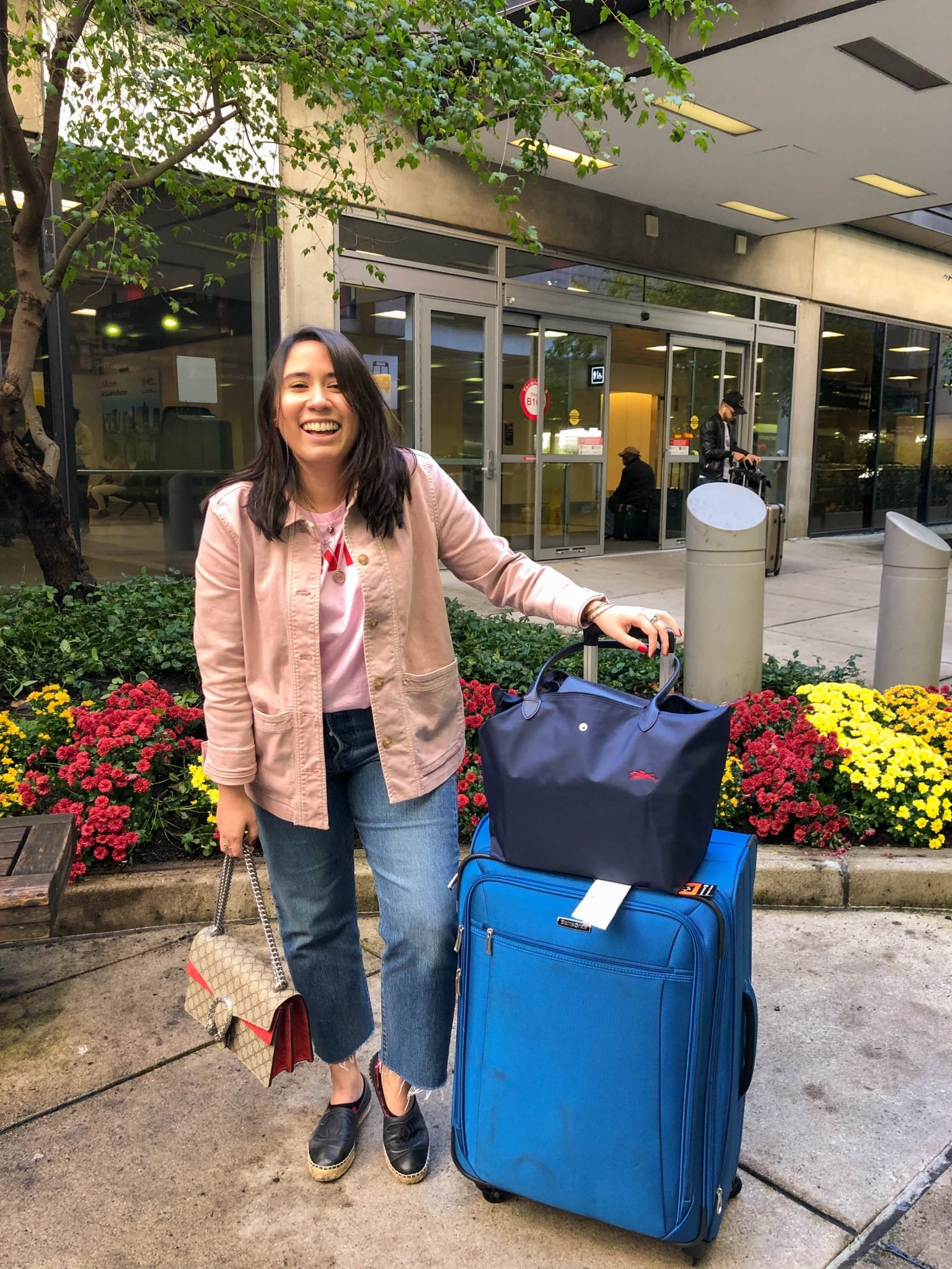 Friday Favorites :: Vietnamese Vacation 2020 by popular New York City lifestyle blog, Live Laugh Linda: image of a woman standing next to some luggage.