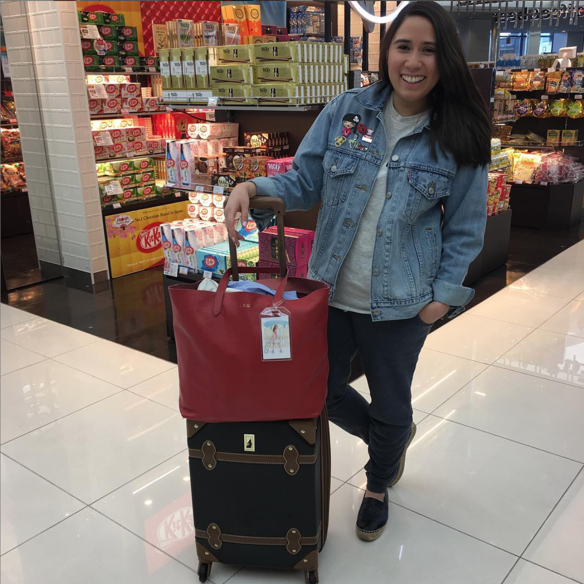 Friday Favorites :: Vietnamese Vacation 2020 by popular New York City lifestyle blog, Live Laugh Linda: image of a woman standing inside an airport terminal.
