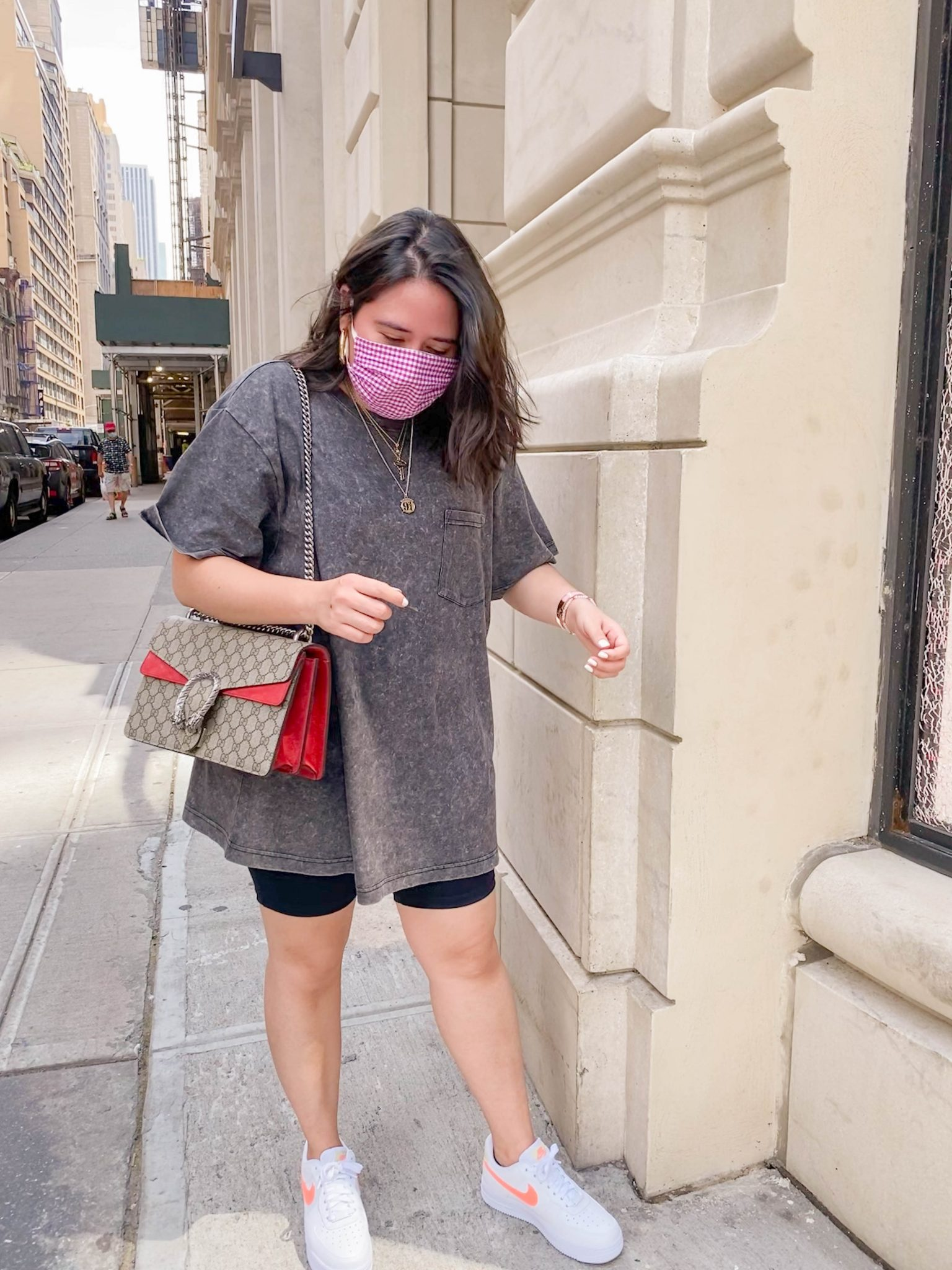 Recent Fashion and Beauty Finds by popular NYC life and style blog, Live Laugh Linda: image of woman outside of Nordstrom Flagship in New York City with Nike Air force 1 women sneakers and Gucci purse