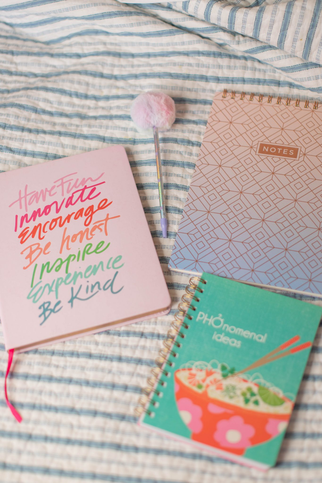 Recent Fashion and Beauty Finds by popular NYC life and style blog, Live Laugh Linda: image of Target office supplies notebooks and pom pom pen
