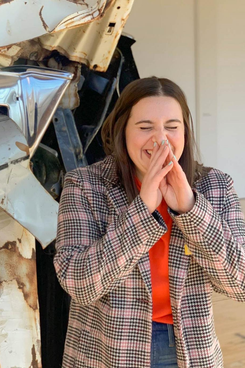 Friends In New York City :: Meet Anna - Senior E-commerce Manager by popular New York lifestyle blog, Live Laugh Linda: image of a woman laughing in a museum.