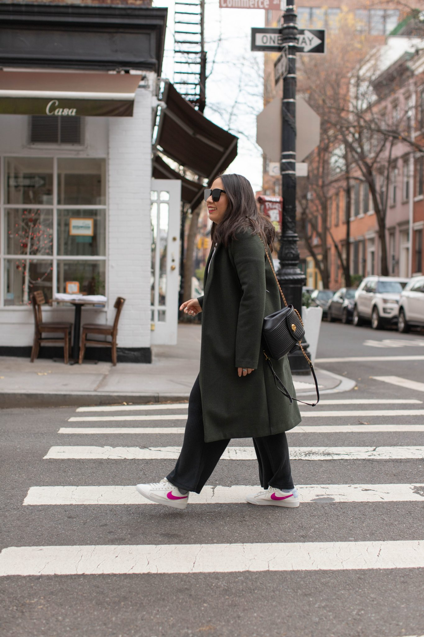 5 Things I Learned About Myself in 2020 by Basically A Mess (image of a woman in loungewear and green overcoat in new york city)