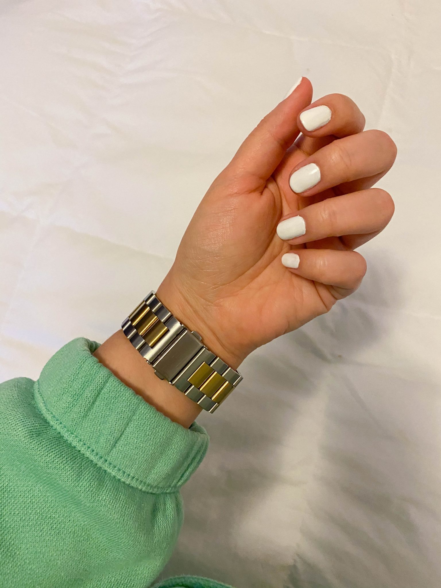 5 Things I'm Currently Loving by Basically A Mess (photo of white nail polish and two tone Apple Watch strap)
