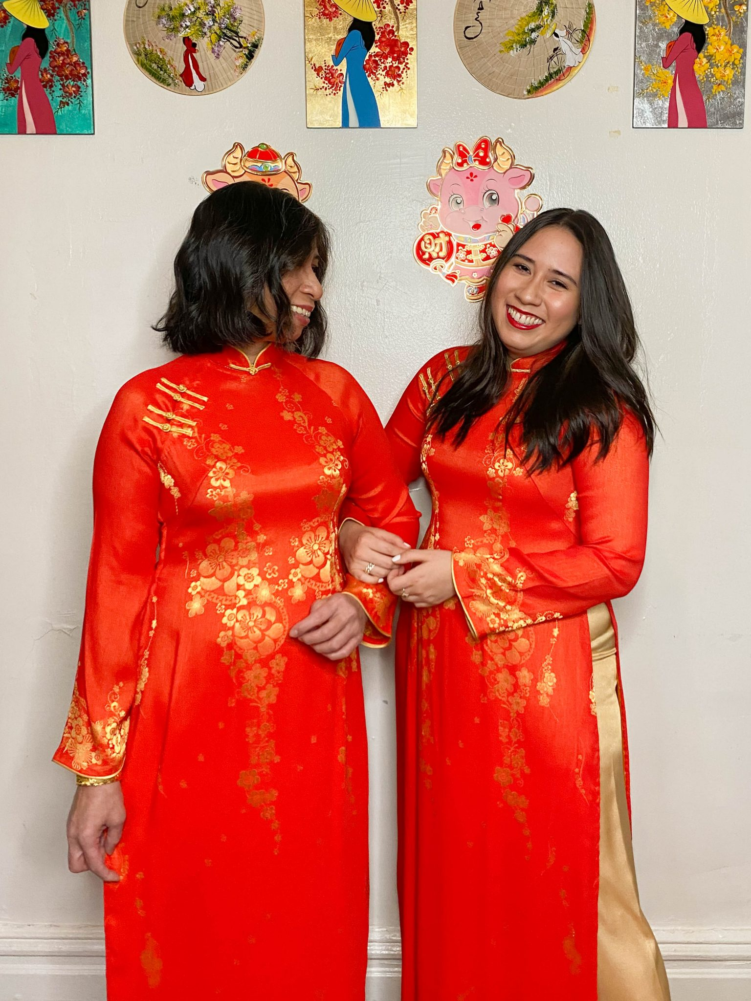 Happy Lunar New Year - Year of the Ox by Basically A Mess (photo of two women in traditional Vietnamese ao dai)