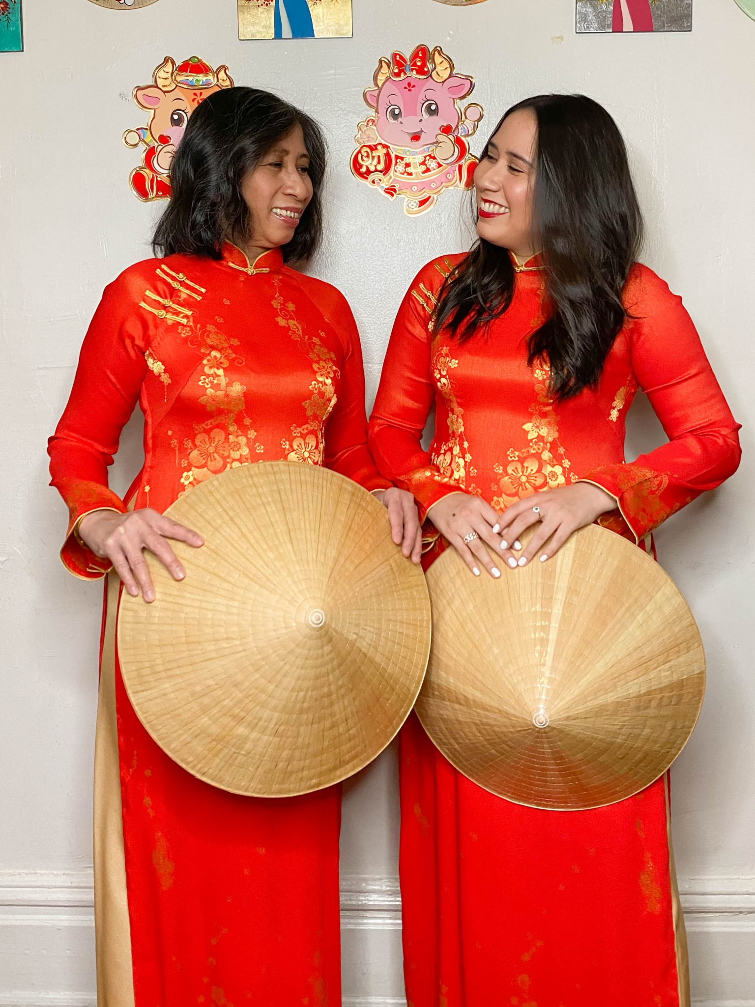 Happy Lunar New Year - Year of the Ox by Basically A Mess (photo of two women in traditional Vietnamese ao dai and rice hats)