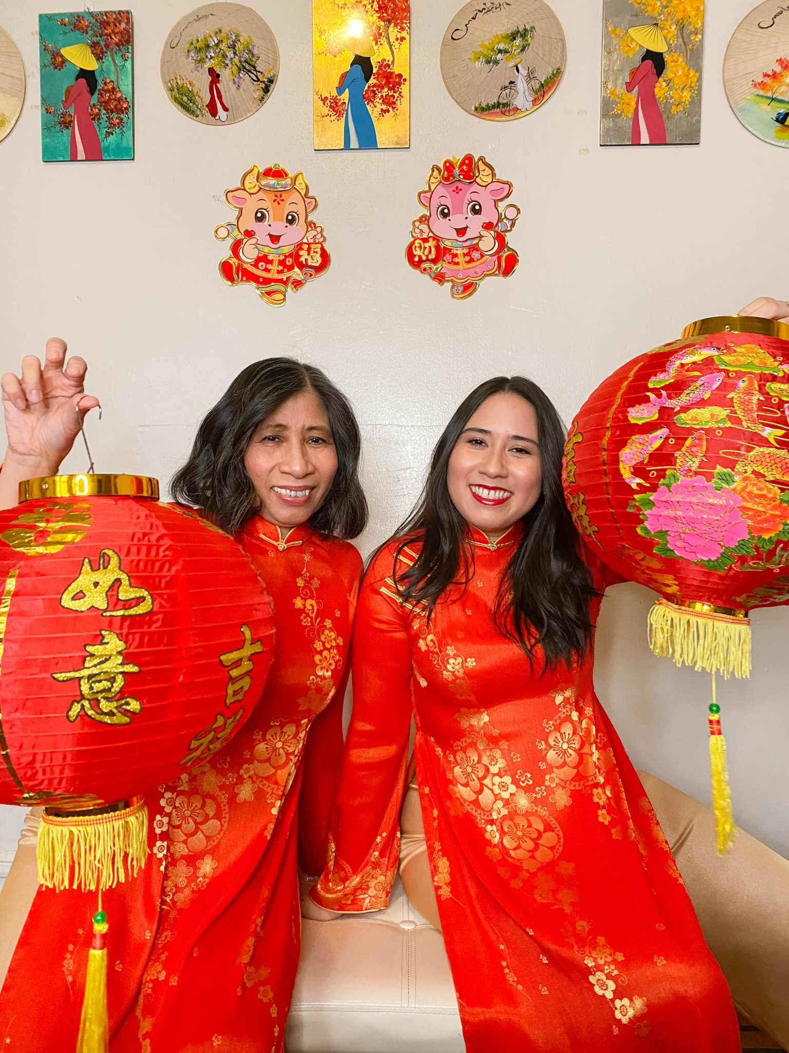 Happy Lunar New Year - Year of the Ox by Basically A Mess (photo of two women in traditional Vietnamese ao dai and red lanterns)