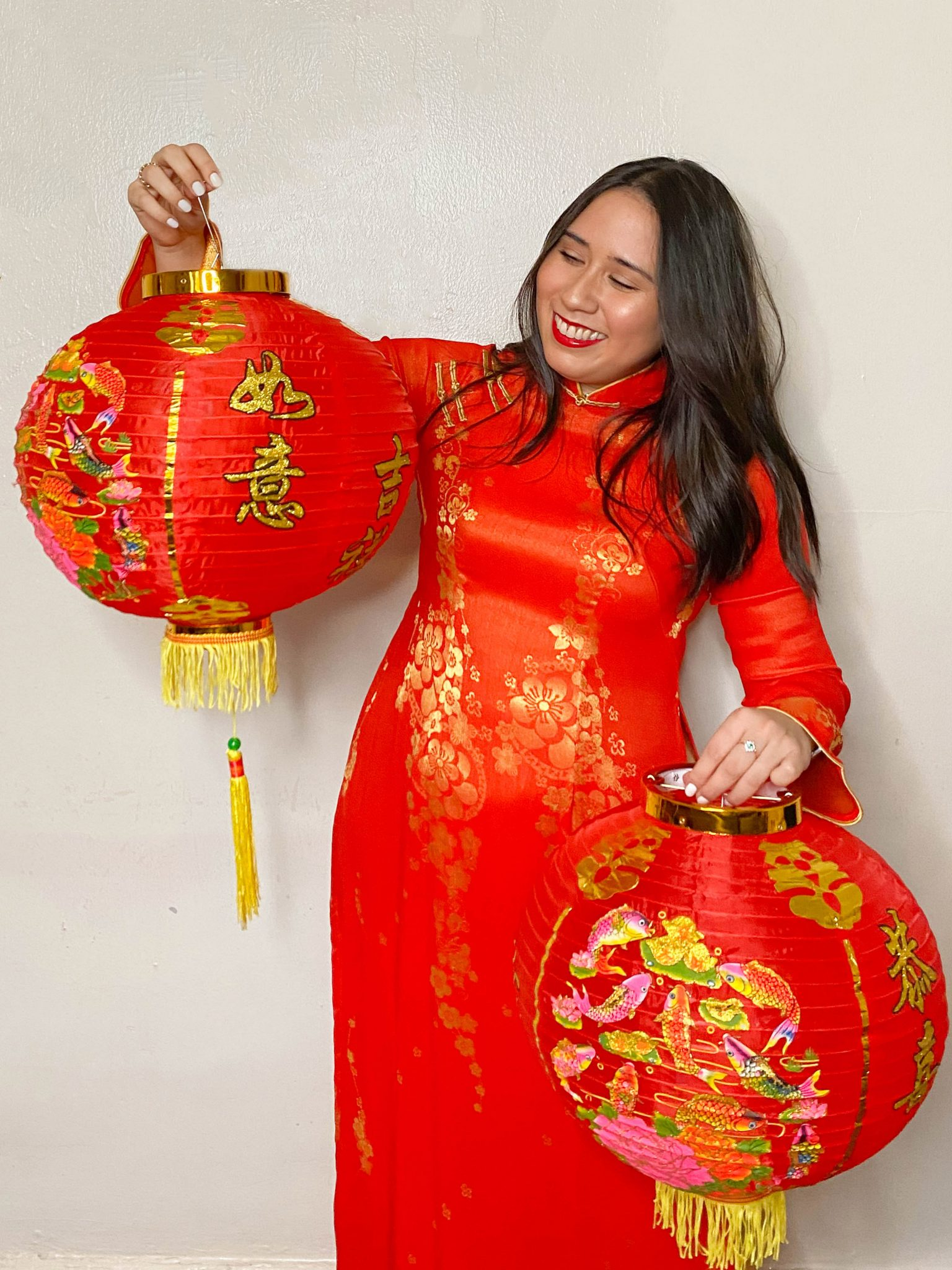 Happy Lunar New Year - Year of the Ox by Basically A Mess (photo of woman in traditional Vietnamese ao dai and red lanterns)