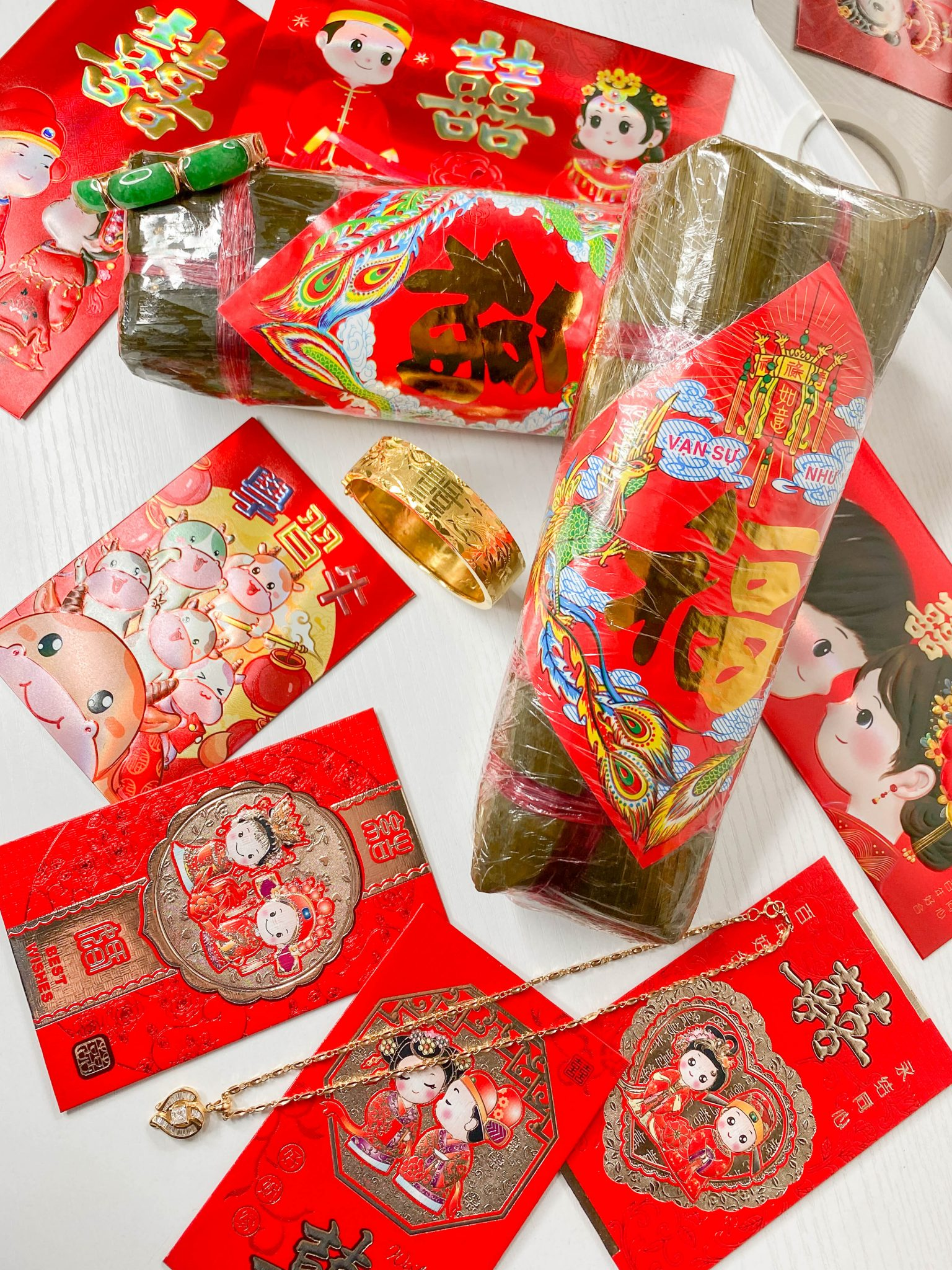 Happy Lunar New Year - Year of the Ox by Basically A Mess (photo of Lunar New Year red envelopes and banh tet)
