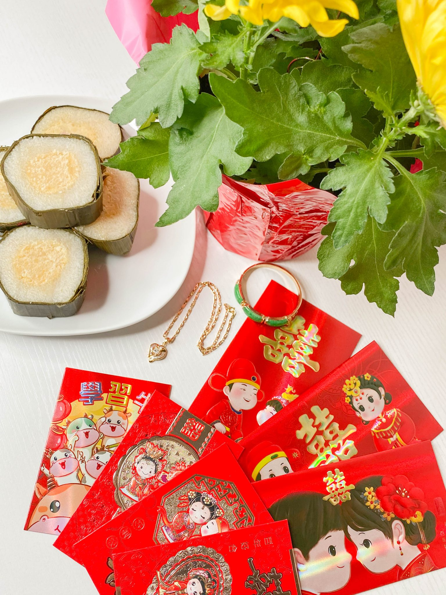 Happy Lunar New Year - Year of the Ox by Basically A Mess (photo of Lunar New Year red envelopes and Vietnamese Banh Tet)