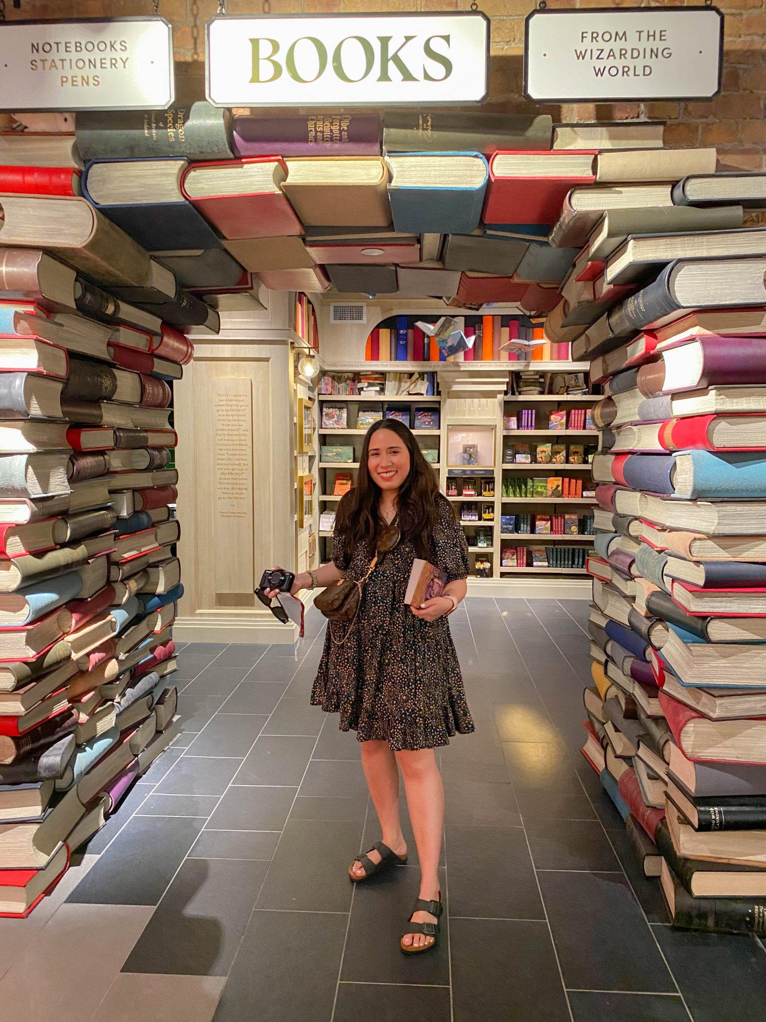 10 Books to Add to your Reading List by Basically A Mess (photo of a woman in the Harry Potter New York store book arch)