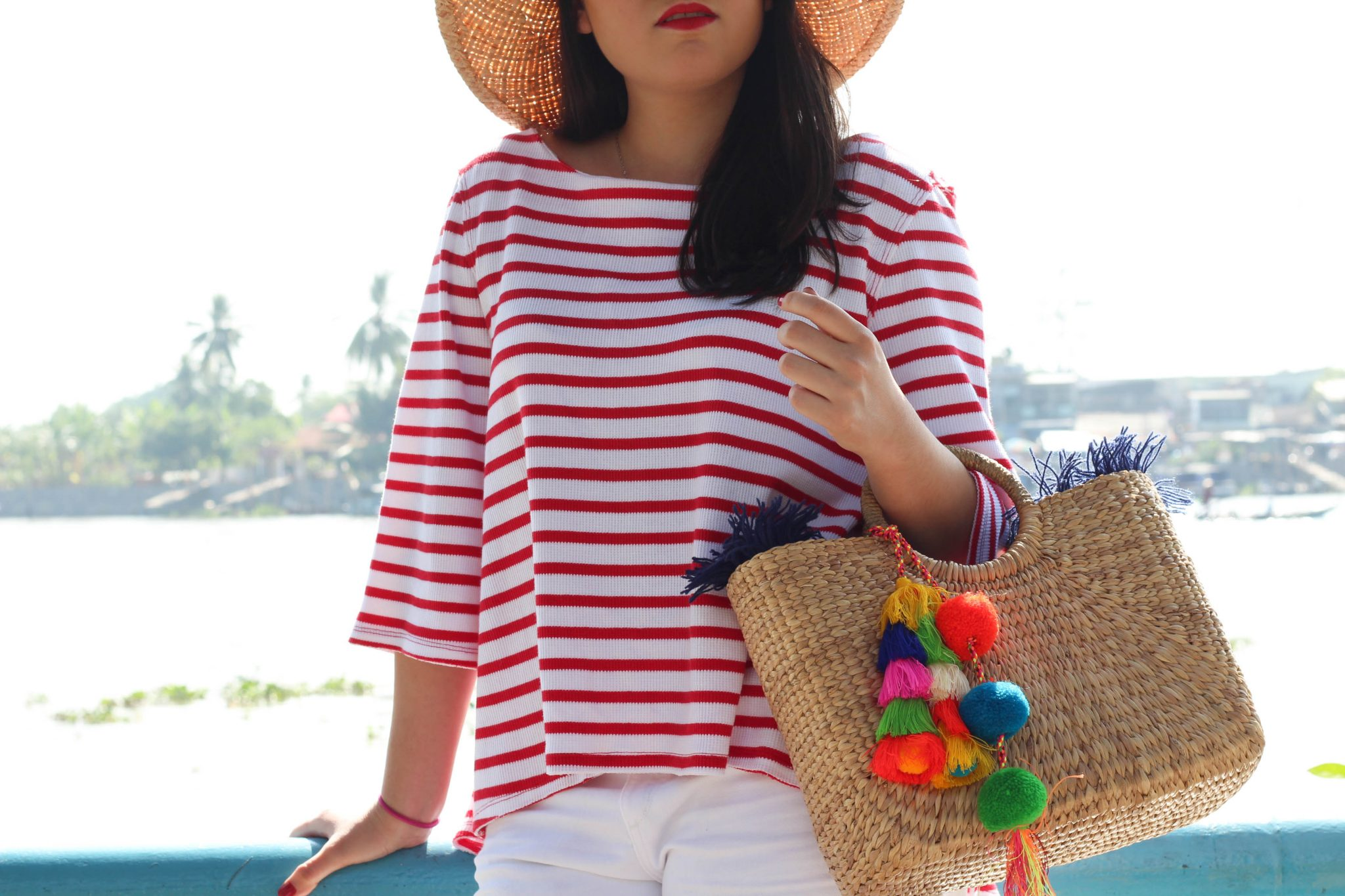 6 Items I've Sold on Poshmark & Why by Basically A Mess (photo of a woman with a JADEtribe straw bag in Vietnam)