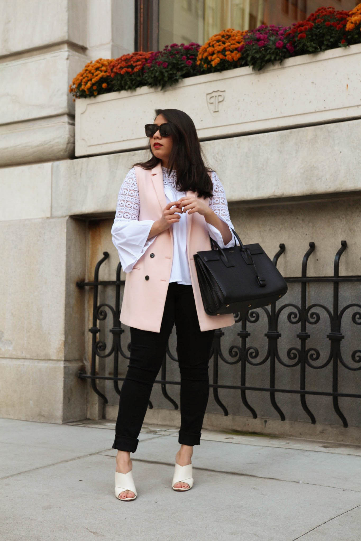 Designer Accessory Wishlist 2021 by Basically A Mess (photo of a woman outside the New York Plaza styling the Saint Laurent sac du jour)